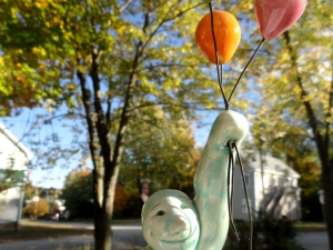 Up and Away for Milo..Handmade ceramic pottery sculpture Man Balloons happy garden